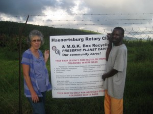 Past President Patricia Baragwanath and Piet Shai, worker at the refuse dump at the recycling skip